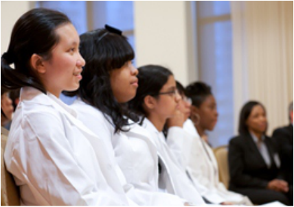 Students are transformed after receiving their personalized white coats (right photo).